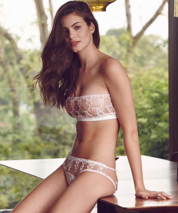 Woman wearing white bridal underwear lingerie set