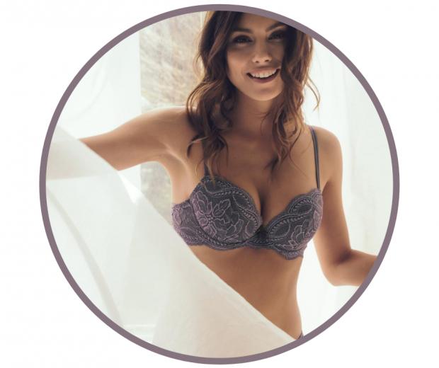 Woman smiling wearing lace push-up bra