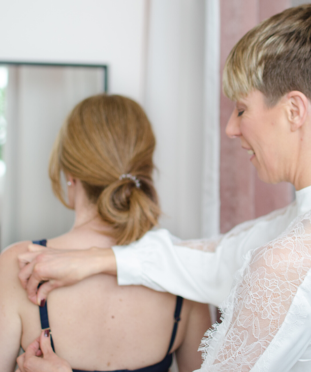 Lingerie Fitting expert Sarah Connelly bra fitting tips to fix bra strap for women in mirror