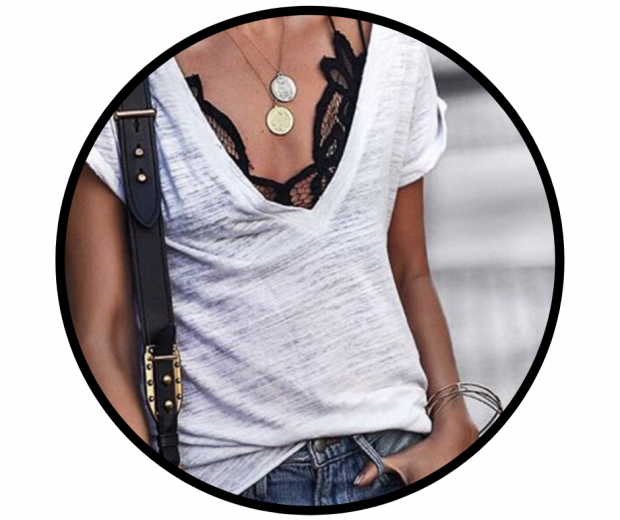 Woman wearing lace bralette with white v-neck t-shirt and jeans
