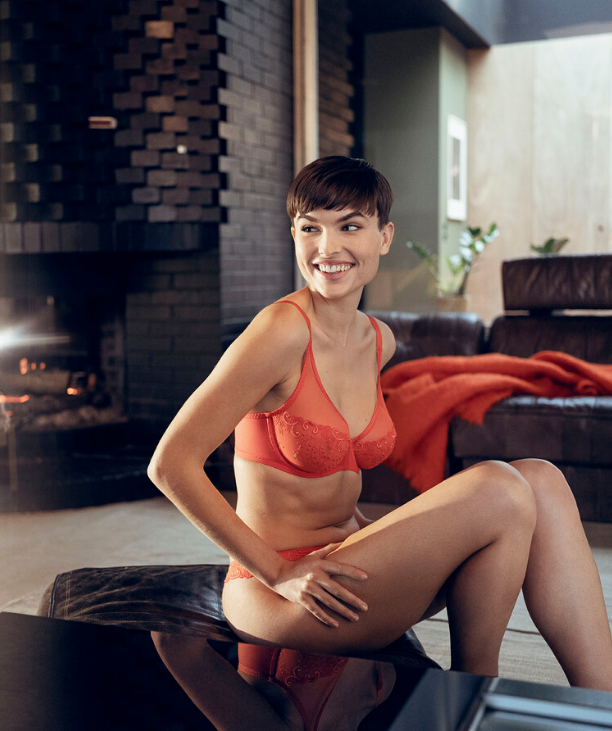 Sarah C - Woman in properly fitting bra Orange Plunge Full-cup Bra