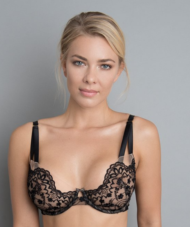 Happy woman wearing black embroidered bra